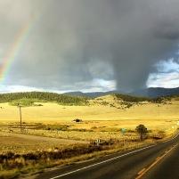 Rainbow During Rainstorm